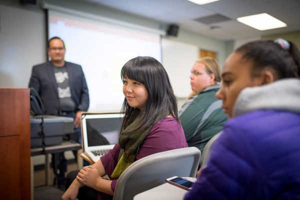 Professor Eric Aoki in the Communication Studies department of the College of Liberal arts with students, October 17, 2018.